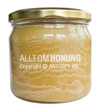 Honung med rimfrostmönster på burken
